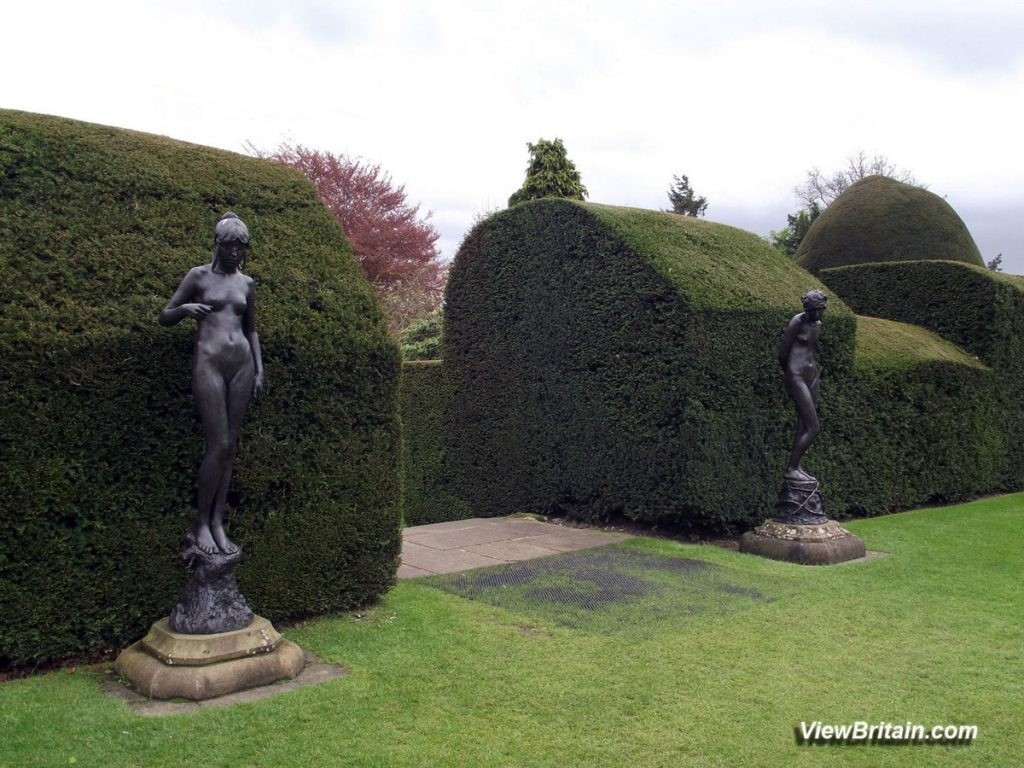 Two-Female-Statues-by-Antonio-Luchessi-at-Chirk-Castle-Wales